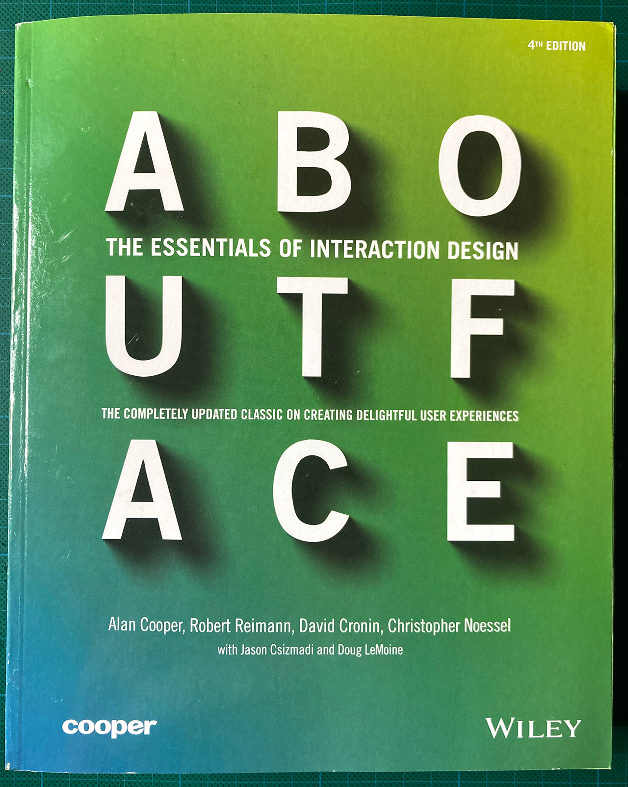 About Face. The essentials of Interactions Design. The complete updated classic on creating delightful User Experiences. 4th ed. Book Cover